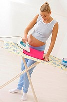 ACTIVE PREGNANT WOMAN INDOORS<BR>Model. Woman 5 months pregnant.