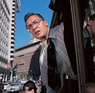 close-up of a businessman leaning out of a bus