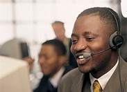 a man wearing a telephone headset and smiling