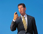 businessman talking into a cassette recorder