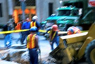 blurred shot of road workers working