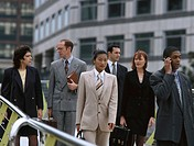 Group of business executives walking outdoors