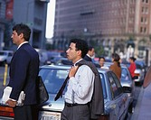Business executives on a busy street