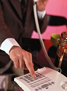 Young businessman operating a telephone