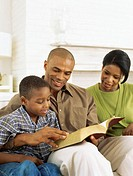 parents and their son reading the bible