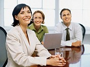 two businesswomen and a businessman in a meeting