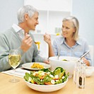 mature couple having dinner