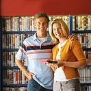 mid adult couple renting a film