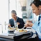 Businessman and businesswoman having lunch