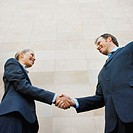 Low angle view of a handshake between a businessman and businesswoman