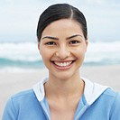 Front view portrait of a woman at beach