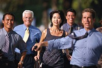 portrait of an business executives running