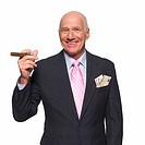 Front view portrait of mature businessman holding cigar