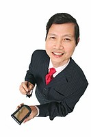 Portrait of businessman holding pda
