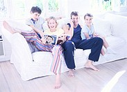 tungsten shot of a family sitting on a couch together