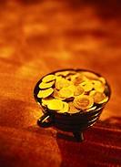 toned high angle view of a pot of gold coins