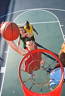 high angle view of a young men playing basketball