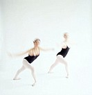 toned view of two young women performing ballet