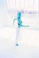 tungsten shot of a young woman dancing