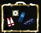 x-ray image of a briefcase carrying a mobile phone with binoculars and spectacles (toned)