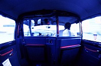 inside view of a taxi with driver sitting in the front