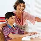 Mother and son (11-12) using a computer
