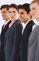 Group of smiling young business executives standing in a row