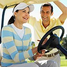 Portrait of two golfers with a golf cart