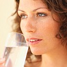 Close-up of a woman drinking glass of water