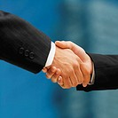 Close-up of a handshake between a businessman and businesswoman