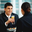 View of a businessman and a businesswoman enjoying lunch