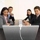 Close-up of four business executives having video conference