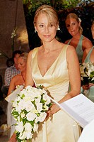 bride holding hand bouquet at her wedding ceremony