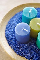 Candles in blue sand