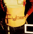 close-up of a woman´s bare midriff with a shadow of the word cyber falling on it
