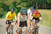 Bicycle riders in full saftey gear riding the public highways of the US south BRAG 2006 Woman leader