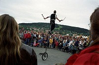 An artist performing on a single wheel ´bicycle´