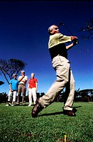 Low angle view of an elderly man playing golf