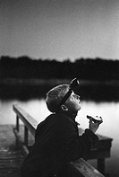 A boy with a lantern looking up at the sky