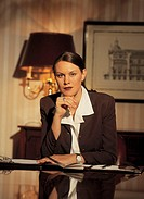 Portrait of a young businesswoman sitting at a desk