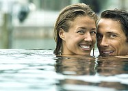 Couple smiling in pool