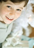 Boy smiling at camera, high angle view