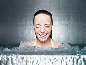 Woman immersing in jacuzzi