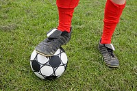 Footballer standing on football