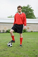 Footballer with football