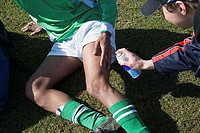 Injured footballer having his leg sprayed