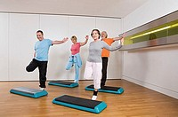 Mature adults doing step aerobics