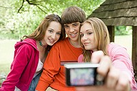 Teenagers posing for photographs