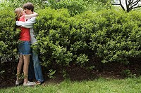 Teenage couple kissing in bush (thumbnail)