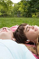 Teenagers listening to an mp3 player